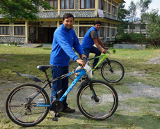 Narayan & Subash setting off by bicycle on a street dog treatment call