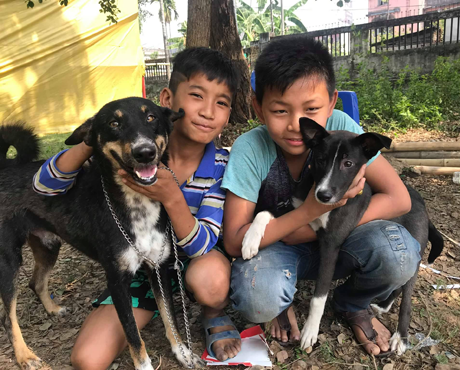 Two young owners with their dogs in Dharan