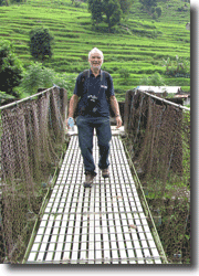 Dr Lyon braves a Nepali rope bridge