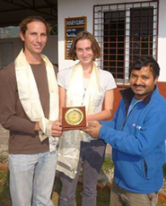 HART's resident vet, Dr Surendra Prasad Kanu, presenting a token of appreciation to Hugh & Holly Simon