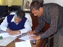 IAAS Dean, Professor Narendra Chaudhary, and HART Director Khageshwaar Sharma sign the MOU
