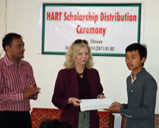 Khim Bahadur Ale being presented with his award by HART co-founder, Barbara Webb