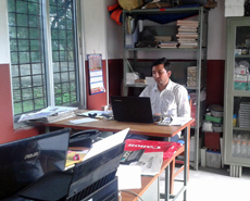 Narayan Dhakal settling in to the new office