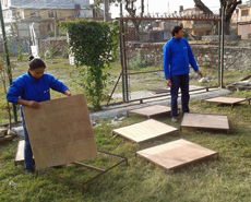 New raised sleeping platforms under construction for the Pokhara kennels