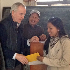 Vet student, Ms Sanam Maharjan, being presented with her HART bursary by visiting vet lecturer, Dr Russell Lyon