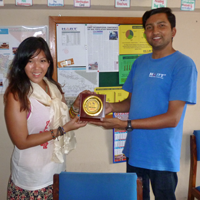 Tracy Yip shown here receiving a token of appreciation from Narayan Dhakal