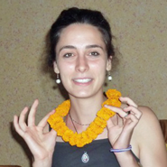 French vet nurse, Zara Izzy, after presentation of her mala - a marigold garland traditionally given as a token of esteem